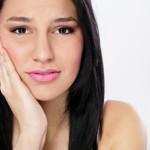 После удаления зуба болит десна